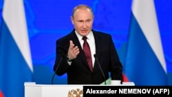 Russian President Vladimir Putin delivers a state-of-the-nation address in Moscow on February 20.