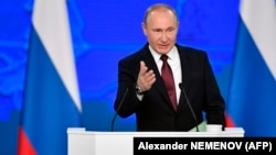 Russian President Vladimir Putin delivers his annual state of the nation address in Moscow on February 20.