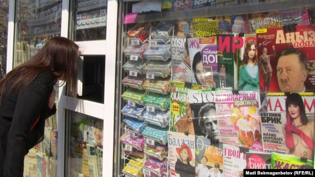 "The April 2014 ""Angyz Adam"" issue dedicated to Adolf Hitler (far right) on a newsstand in Almaty."