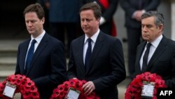 Liberal Democrat leader Nick Clegg (left), Conservative leader David Cameron (center), and Prime Minister Gordon Brown attend a Victory Day memorial service at the Cenotaph in London on May 8.