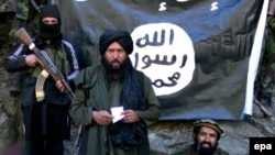 Image from a video released by the Islamic State group (IS) on January 27, 2015 purportedly showing Hafiz Said Khan, center, head of the IS branch in Pakistan and Afghanistan, at an undisclosed location on the Afghanistan-Pakistan border.