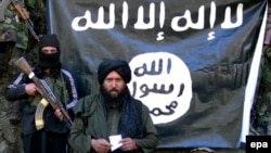 An image made from a video released by the Islamic State (IS) on 27 January 2015 purportedly showing Hafiz Said Khan (C) head of the IS branch in Pakistan and Afghanistan.