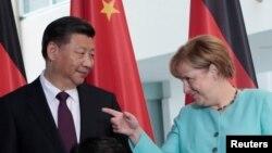 Сі Цзіньпін і Анґела Меркель під час зустрічі в Берліні, 5 липня 2017 року