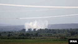 Missiles fired by opposing sides in the Nagorno-Karabakh war hit a district in Iran's East Azerbaijan province.