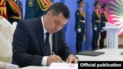 Kyrgyz President Sadyr Japarov signing the new bill into law on May 5.