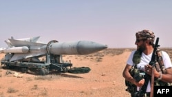 Libya -- A Libyan NTC fighter looks at a Scud missile at Al-Burkan base (codenamed K9), 70 kms from Bani Walid, southeast of Tripoli, 02Sep2011