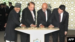 Indian Vice President, Hamid Ansari (L), along with Turkmen President Gurbanguly Berdymukhamedov (R), Afghan President Ashraf Ghani (2R) and Pakistani Prime Minister Nawaz Sharif press the button to launch the construction of TAPI gas pipeline in December 2015.