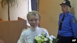 Yulia Tymoshenko, not a hair out of place, stands inside the court hearing room in Kyiv on August 10, after spending another night in the capital's Lukyanovsky detention center.