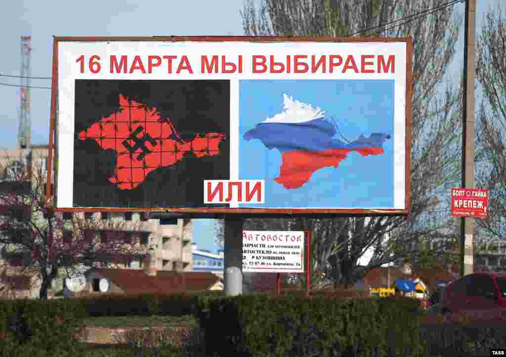 A pro-Moscow billboard in Sevastopol, equating life in Ukrainian Crimea with life under fascism, urges a yes vote in the referendum on joining Russia that was set by Crimean legislators for March 16. (ITAR-TASS/Stanislav Krasilnikov)