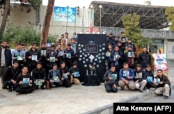 Iranian students hold pictures of the victims during a memorial for the passengers of the Ukrainian airliner at the University of Tehran on January 14.