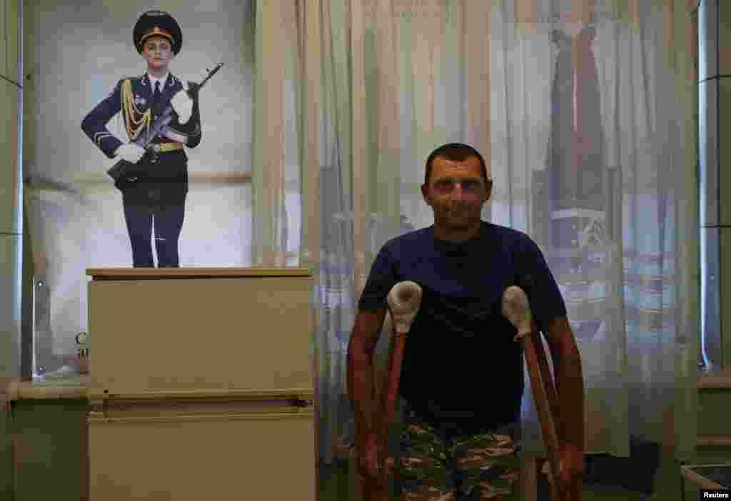 An injured pro-Russian separatist from the so-called Vosotk Battalion poses for a picture at a hospital, located at the base of the battalion, in Donetsk, eastern Ukraine. (Reuters/Maksim Zmeyev)