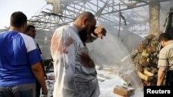 На месте взрыва на рынке в Багдаде, 13 августа 2015 года.