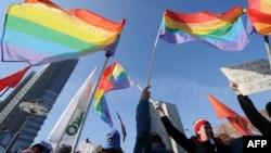 Gay rights activists take part in a rally against laws restricting the rights of homosexuals in downtown Moscow on March 10.
