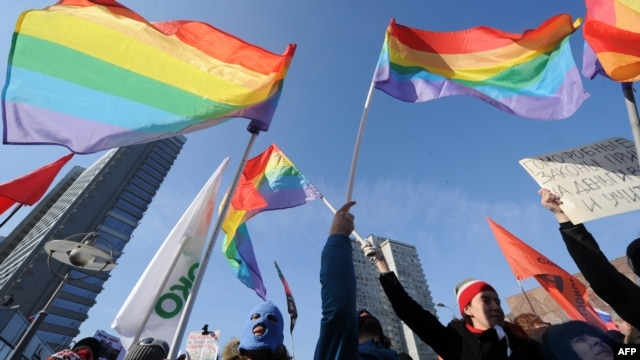 Gay rights activists take part in a rally against homophobic laws in Moscow earlier this month.