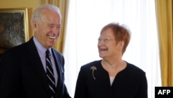 U.S. Vice President Joe Biden shares a laugh with Finnish President Tarja Halonen at the Presidential Palace in Helsinki.