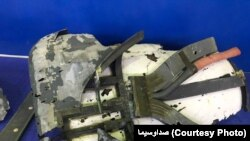 """IRANIAN STATE TELEVISION SHOWS WHAT IT CALLS """"RETRIEVED SECTIONS OF U.S. MILITARY DRONE"""" DOWNED BY IRAN. June 21, 2019"""