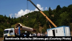 The minaret from a mosque in Chela, Georgia, being unloaded following a customs inspection in Tbilisi.