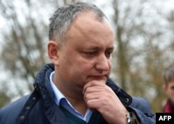 Igor Dodon told reporters that his party has nothing to do with an anonymous leaflet smear campaign. (file photo)