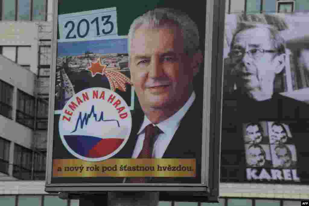 A billboard features presidential candidate Milos Zeman (left); beside it is a photograph of former Czech President Vaclav Havel wearing a T-shirt showing presidential candidate and Foreign Minister Karel Schwarzenberg.