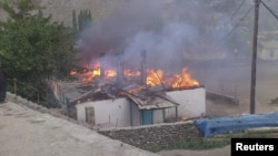 Tajikistan -- A building believed to be a hostel is set ablaze during fighting in the town of Khorog, capital of the autonomous region of Gorno-Badakhshan, 24Jul2012