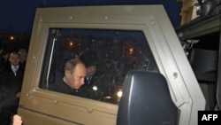 Russian Prime Minister Vladimir Putin inspects a Tiger armored military jeep near Sverdlovsk in December 2008.