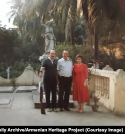 Russia's ambassador to Bangladesh (left) holds Martin's rifle as he poses for a photo with the couple.