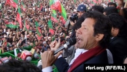 Imran Khan speaks to supporters during a rally in Koita on April 20.