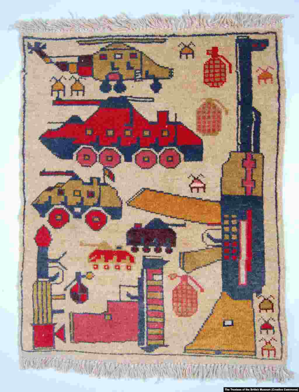 A colorful weave of weaponry, including a Soviet-made rocket-propelled grenade (lower left). Since the end of the Soviet occupation in 1988, Afghanistan's war rugs have evolved to illustrate the conflicts that have followed.