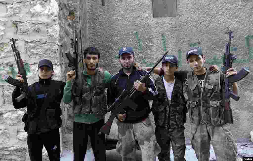 Five brothers who are members of a rebel group called Martyr Al-Abbas pose for a picture in Aleppo, Syria. The brothers said the group, which consists of other members, is operating under the Free Syrian Army and was first established in the memory of their brother Abbas Sheikh Yasine, who died in fighting against government forces. (Reuters/Muzaffar Salman)