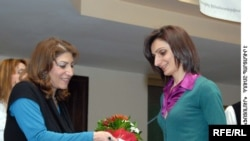Karine Simonian receives her award in Yerevan