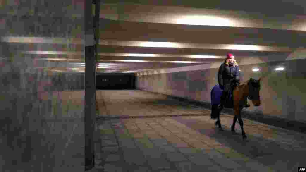 A woman rides a horse in an underground passage in Moscow. (AFP/Vasily Maksimov)