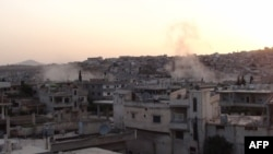 Syria -- Shelling on Rastan, near the central rebel hotbed of Homs, 18May2012