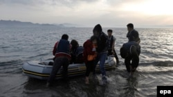 Afghan migrants disembark on a beach on the Greek island of Kos after crossing the strait from Turkey, in May.