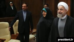 Iranian Vice President for Women's Affairs Masoumeh Ebtekar (center) recently attended a cabinet meeting and sat a few seats away from President Hassan Rohani (right).