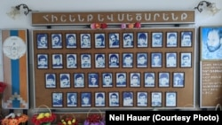 A wall of photos at Taghavard's school showing local fighters killed in the first Nagorno-Karabakh War (1988-94).
