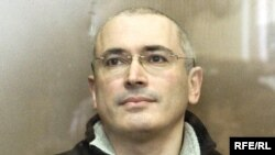 Mikhail Khodorkovsky sits inside the bulletproof defendents' cage of a Moscow court on March 3.