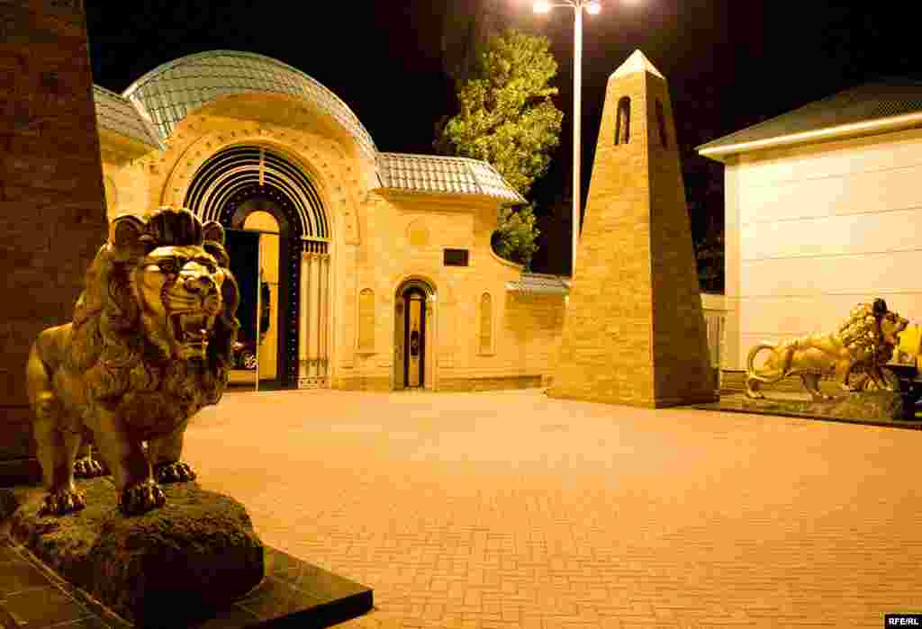 Lion sculptures guard the entrance to Kadyrov's mansion.