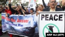 Amid heightened tensions with India, Pakistani civil society activists march in a peace rally in Lahore on February 28.