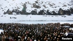Afghan villagers perform funeral prayers for avalanche victims in Panjshir Province on February 26.