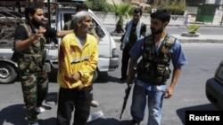 Паранены жыхар Алепа, 10 жніўня, 2012