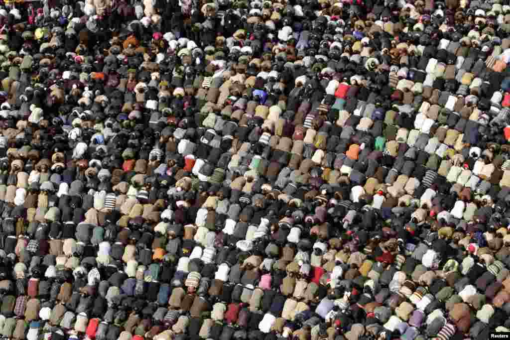 Opposition supporters attend Friday Prayers on Tahrir Square on February 11, 2011.