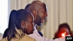 The family of Trayvon Martin speak before the City of Sanford commissioners, in Sanford, Florida on March 26