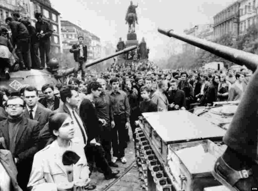 Soviet tanks are surrounded by crowds of Czechs protesting against the invasion on Prague's Wenceslas Square on August 21, 1968.