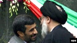 President Mahmud Ahmadinejad (left) hugs judiciary Chief Mahmud Hashemi Shahrudi after the presidential swearing-in ceremony in parliament on August 5.