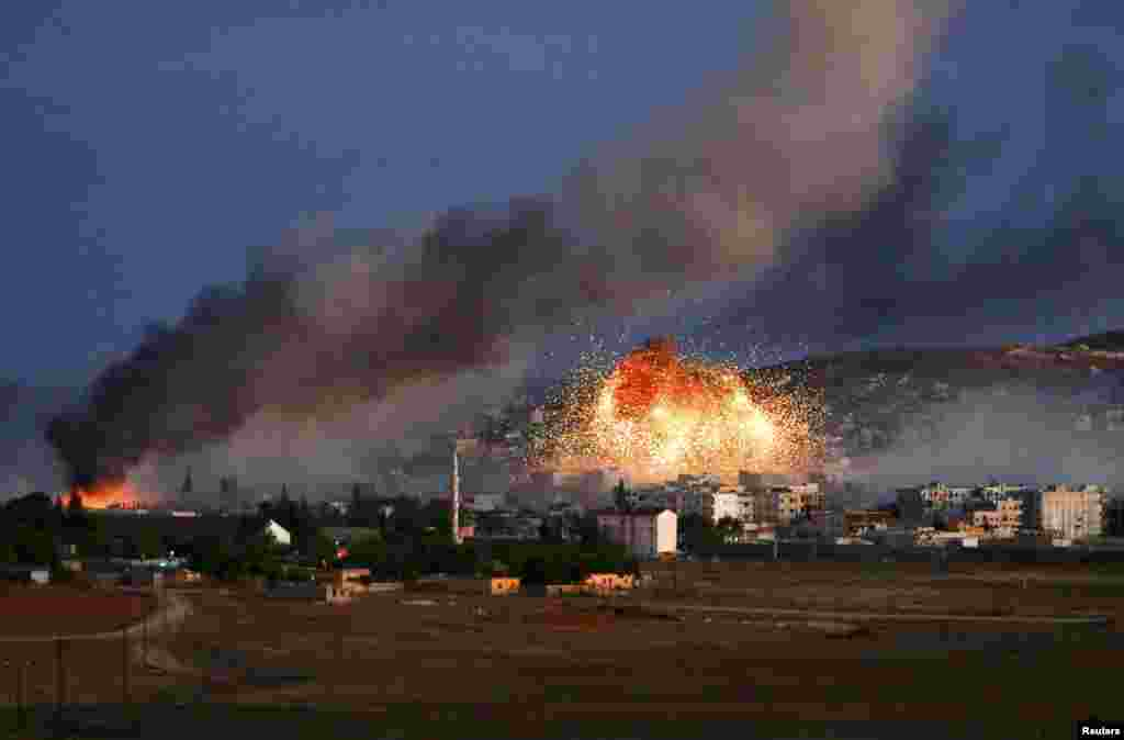 Smoke and flames rise over the Syrian town of Kobani after an air strike against Islamic State militants by a U.S.-led coalition. (Reuters/Kai Pfaffenbach)