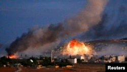 Pamje nga sulmet e të hënës në Kobani