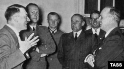 German Foreign Minister Joachim von Ribbentrop (right) talks with Adolf Hitler (left) on his arrival to Berlin after signing the 1939 Molotov-Ribbentrop Pact.