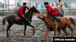 """An image from the Azerbaijani Culture Ministry showing riders in a typical """"chovqan"""" match"""