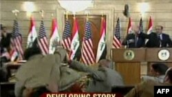 President George W. Bush ducking as Muntadhir al-Zaidi threw his shoes at him on December 14.