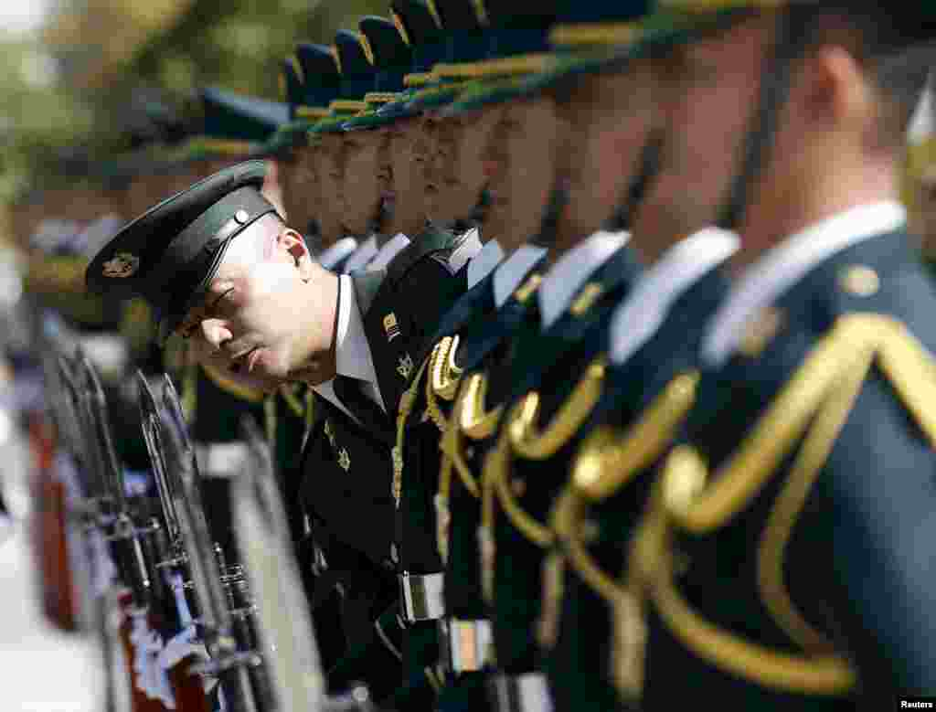 Members of Japan's Self-Defense Force's honor guard prepare for a ceremony for U.S. Army General Martin Dempsey, chairman of the Joint Chiefs of Staff, at the Defense Ministry in Tokyo. (Reuters/Toru Hanai)